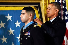 President Barack Obama bestows the Medal of Honor to Florent Groberg during a ceremony in the East Room of the White House, Nov. 12, 2015.