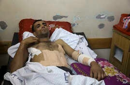 Marwan Shtewi, 32, lies in the surgery's ward of Shifa hospital in Gaza City, May 16, 2018. Shtewi was shot in his hand and abdomen by Israeli troops during a protest east of Gaza City on Monday. With few prospects and little to fear, Shtewi is among