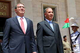 Iraq's Defense Minister Khaled al-Obeidi stands with U.S. Defense Secretary Ash Carter (L) during a welcoming ceremony at the defense ministry in Baghdad July 23, 2015.