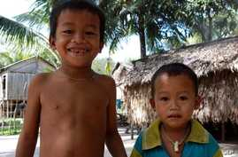 Two S'aoch children in their village in Cambodia. Neither of them speaks S'aoch, 19 Jan 2010