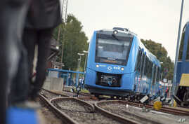 A fuel cell train, which is powered by hydrogen, arrives in Bremervoerde, northern Germany, Sept. 16, 2018.