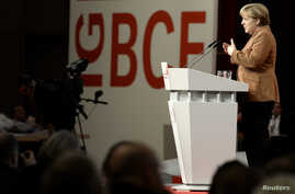 German Chancellor Angela Merkel (CDU) delivers her speech at a congress of the Industrial Mining, Chemistry, Energy Union (IG BCE) in Hanover, Oct. 16, 2013.