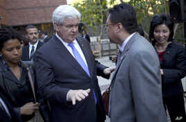 Former Republican presidential candidate Newt Gingrich meets with Asian-Americancampaign stop earlier this year. Recent polls suggest Asian-American voters could impact the upcoming presidential election.