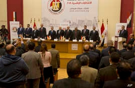 Members of the National Electoral Commission which is in charge of supervising the 2018 Egyptian presidential election, stand for the national anthem before a press conference at the commission headquarters in Cairo, Egypt, Monday, Jan. 8, 2018.