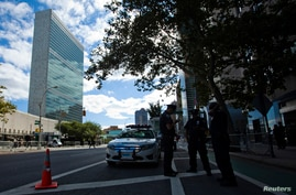 New York police officers stand guard in front of the U.N. headquarters ahead of the start of the U.N. General Assembly in New York, Sept. 22, 2013.