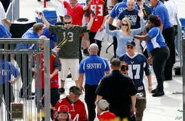 Football fans are screened by security as they enter Raymond James Stadium before the start of an NFL football game between the Tampa Bay Buccaneers and the Dallas Cowboys, Nov. 15, 2015, in Tampa, Fla.