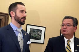 West Virginia Senate Majority Leader Ryan Ferns, R-Ohio, left, and House Education Chairman Paul Espinosa, R-Jefferson, discuss an agreement reached by a legislative conference committee for a 5 percent pay increase for striking teachers Tuesday, Mar