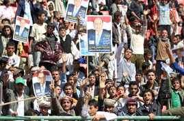 People carry posters of Yemen's Vice President Abed Rabbo Mansour Hadi during an election rally in Sana'a, February 20, 2012.