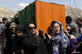 FILE - Afghan women's rights activists carry the coffin of Farkhunda, an Afghan woman who was beaten to death and set alight on fire March 19, during her funeral ceremony in Kabul, March 22, 2015.