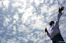 FILE - Merera Gudina, a leader of Ethiopia's biggest opposition coalition, Medrek, addresses supporters at a rally in the Oromia region, May 15, 2010.