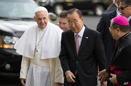 Pope Francis arrives in front of United Nations headquarters with Secretary General Ban Ki-moon, Sept. 25, 2015.