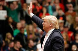 Republican presidential candidate, Donald Trump waves to the crowd during a rally at Radford University in Radford, Virginia, Feb. 29, 2016.