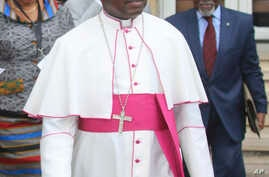 FILE - Monseigneur Marcel Utembi, a Catholic church mediator arrives for a meeting in Kinshasa, Democratic Republic of Congo, Wednesday, Dec. 21, 2016.