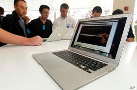 FILE - The new Apple Macbook Air laptop is seen on display at Apple headquarters in Cupertino, Calif.