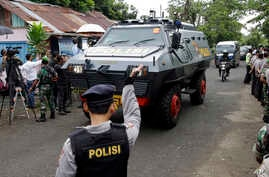 One of the Indonesian police armored vehicles carrying two Australian prisoners arrives at Wijaya Pura port in Cilacap, Central Java, Indonesia, Wednesday, March 4, 2015.