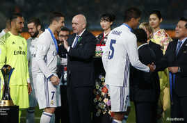 Real Madrid's Cristiano Ronaldo with Fifa President Gianni Infantino after a match between Real Madrid and the Kashima Antlers at International Stadium Yokohama - Japan, Dec. 12, 2016.