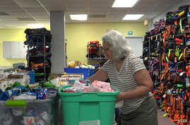 "Linda Walker has been volunteering with the nonprofit for the past six months. ""I felt immediately that Comfort Cases had a role to play in the immigrant issue; reaching those children,"" Walker said."