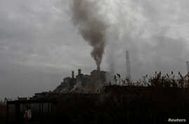 FILE - Smoke rises from a coal-fired power plant in Obilic near Pristina, Kosovo, Nov. 1, 2018.