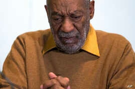 FILE - In this Nov. 6, 2014 file photo, entertainer Bill Cosby pauses during a news conference.