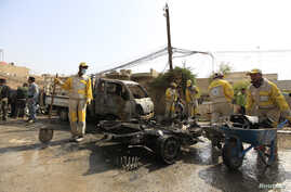 Municipality workers clean the site of a bomb attack in Baghdad, March 5, 2014.