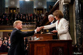President Donald Trump before delivering the State of the Union address, with Vice President Mike Pence and Speaker of the House Nancy Pelosi, at the Capitol in Washington, Feb. 5, 2019.