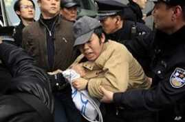 Heavy Police Presence Thwarts Call for Protests in China
