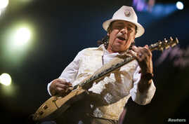 Mexican guitarist Carlos Santana performs onstage during the 45th Montreux Jazz Festival in Montreux July 2, 2011. Over 350 artists and groups will perform on the two main stages and at the ten free venues during the sixteen-day long festival.  REUTE