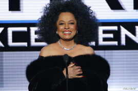 FILE - Diana Ross presents the Dick Clark Award for Excellence during the 42nd American Music Awards in Los Angeles, California Nov. 23, 2014.