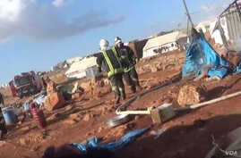 This screenshot from a video posted by the 'White Helmet'  Syrian civil defense group shows the aftermath of what opposition groups say was an airstrike at the Kamouna refugee camp.