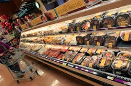 FILE -  A customer checks out the ready made food section at a grocery store in Cincinnati, Ohio.