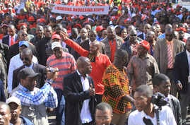 Leader of the main opposition party, Nelson Chamisa, centre, waves at supporters during a march on the streets of Harare, Wednesday, July 11, 2018.