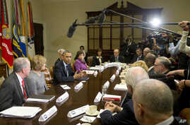 President Barack Obama makes a statement before the start of a meeting with representatives of health insurance companies, in the Roosevelt Room of the White House, in Washington, Nov. 15, 2013.