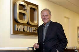 "FILE - ""60 Minutes"" executive producer Jeff Fager poses for a photo at the ""60 Minutes"" offices, in New York, Sept. 12, 2017."