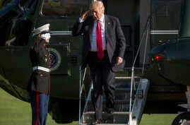 President Donald Trump steps off Marine One as he arrives at the White House in Washington, Friday, April 28, 2017.