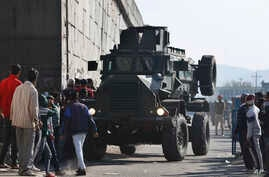 An Indian armored vehicle moves near an Indian air force base in Pathankot, 430 kilometers (267 miles) north of New Delhi, India, Jan. 2, 2016. Gunmen attacked the air force base near the border with Pakistan early Saturday.
