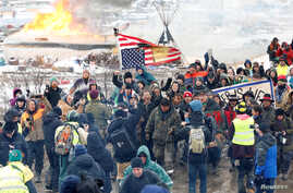 Opponents of the Dakota Access oil pipeline march out of their main camp near Cannon Ball, North Dakota, U.S., Feb. 22, 2017.