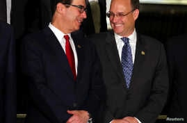 U.S. Secretary of the Treasury Steven Mnuchin talks to Financial Action Task Force President Marshall Billingslea as they pose for the official photo at the G20 Meeting of Finance Ministers in Buenos Aires, Argentina, July 21, 2018.