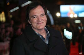 Director Quentin Tarantino poses for photographers upon arrival at the premiere of the film 'The Hateful Eight' in London, Dec. 10, 2015.