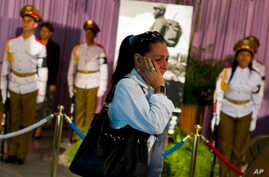 A woman weeps as she pays her final respects to the late leader Fidel Castro at Revolution Plaza in Havana, Cuba, Nov. 28, 2016. Castro died Friday at the age of 90.