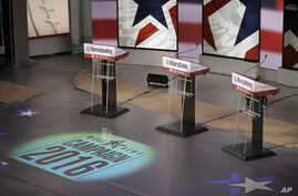 The podiums are ready for Saturday night's Democratic presidential debate between Sen. Bernie Sanders, former Secretary of State Hillary Clinton and former Maryland Gov. Martin O'Malley, in Des Moines, Iowa, Nov. 13, 2015.