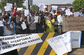 Protesters calling for the release of Lt. Gen. Karenzi Karake demonstrate outside the British High Commission in Kigali, Rwanda,  June 24, 2015.