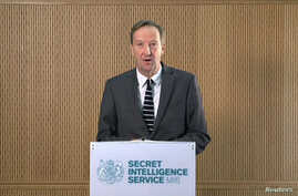 MI6 chief Alex Younger speaks at MI6's Vauxhall Cross headquarters in central London, in this still image from video, Thursday, Dec. 8, 2016. Younger said Britain and Western nations are facing grave threats to their security and political systems fr