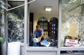 A man removes stones at the Thai honorary consulate in Istanbul, Turkey, July 9, 2015.