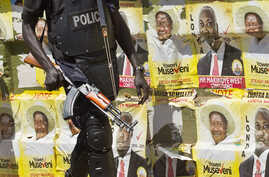 An armed Ugandan riot policeman is seen on patrol against the backdrop of campaign posters for long-time President Yoweri Museveni, as well as local members of Parliament, on a street in Kampala, Uganda, Feb. 17, 2016.