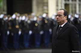 French President Francois Hollande attends a ceremony during a visit to the French anti-terror security forces (Sentinelle) at Paris police headquarters, Jan. 7, 2016.