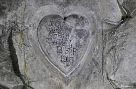 Inscriptions by WWI soldier J.G. Gibb, 2nd Highland Light Infantry, are seen on the rock in underground caves accessible by small spiral stairs in the village's church at Bouzincourt, northern France, July 13, 2015.