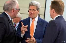 U.S. Secretary of State John Kerry, center, speaks with Dutch Foreign Minister Frans Timmermans, left, and Norwegian Foreign Minister Borge Brende, during a meeting of the North Atlantic Council in Foreign Ministers Session at NATO headquarters in Br