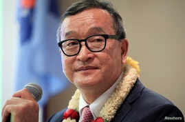 FILE - Cambodian opposition leader Sam Rainsy delivers a speech to members of the Cambodia National Rescue Party (CNRP) at a hotel in metro Manila, Philippines, June 29, 2016.