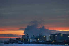 FILE - In this Jan. 11, 2016 photo, dawn approaches over the meat processing plant owned and run by Cargill Meat Solutions, in Fort Morgan, a small town on the eastern plains of Colorado.