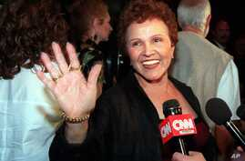Maria Elena Holly, Buddy Holly's widow, arrives at the Buddy Holly Tribute and Rock and Roller Dance Party at New York's Roseland Ballroom, Sept. 7, 1999.